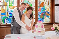 Scaplen's Court Wedding - Cutting cake.jpg